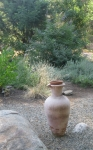 Vase with native rock, gravel walkway